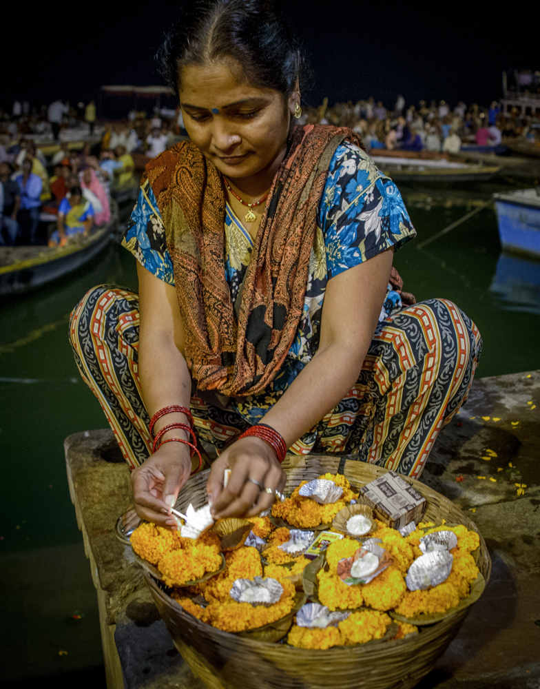 Woman selling lit candles