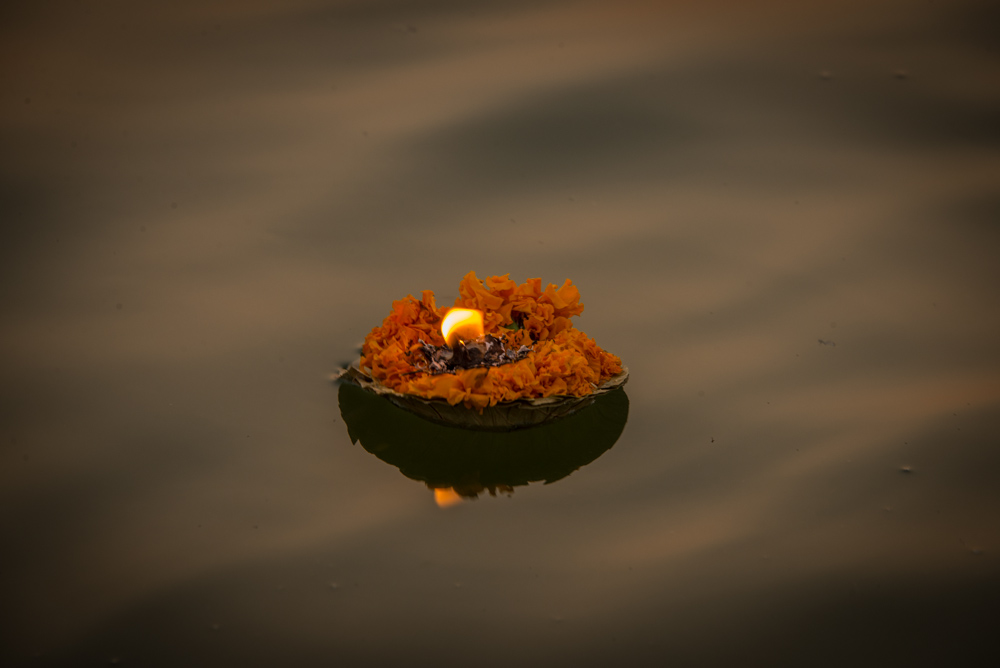 Lit candle on the ganges