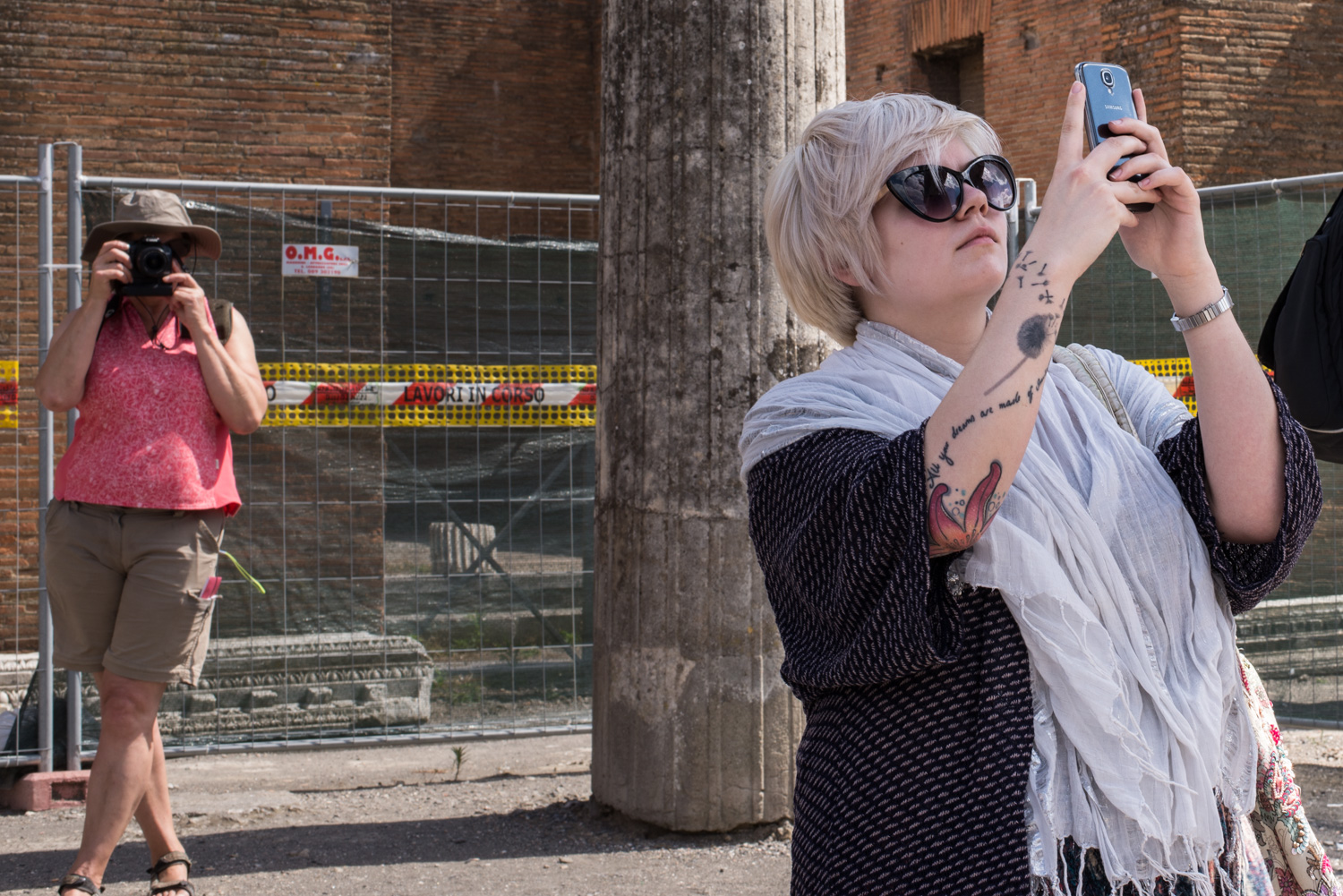 A woman taking a photo of woman taking a photo