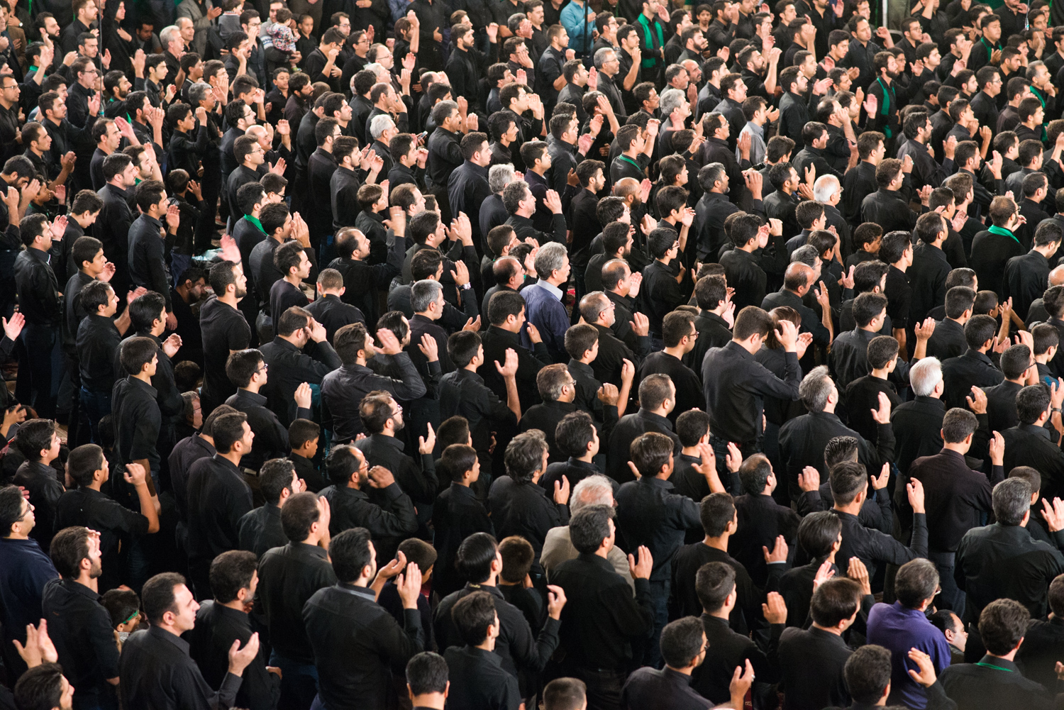 Men attending one of the many Ashura rituals at Esphahan, Iran. The orchestrated intensity of expressions of grief are devoutly followed.