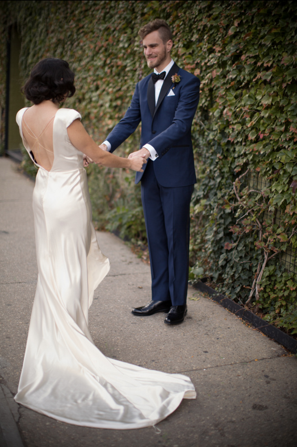 hushed commotion back chain wedding dress.png
