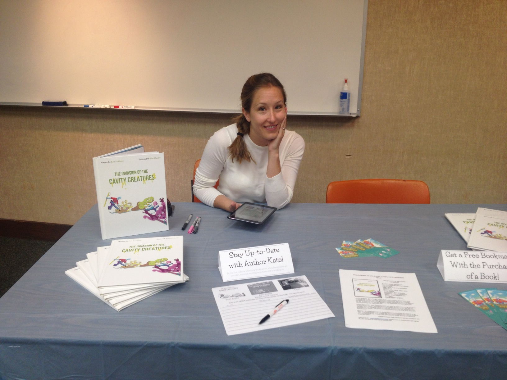 "Here I sit at my very first author signing and reading of ""The Invasion of the Cavity Creatures""!  I was SO nervous that morning that a little bit I cried, hence the puffy eyes!"