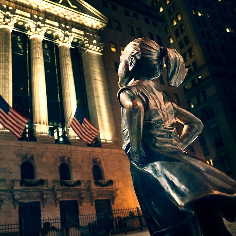 - Now standing defiantly in front of the New York Stock Exchange, the 'Fearless Girl' statue which has captivated people around the world, continues its mission to drive social and economic change and showcase the power of women in leadership in some of the world's biggest companies. We're very proud to have scored this State Street Global Advisors' 'Fearless Girl' film.Check out what the New York Times had to say about it.