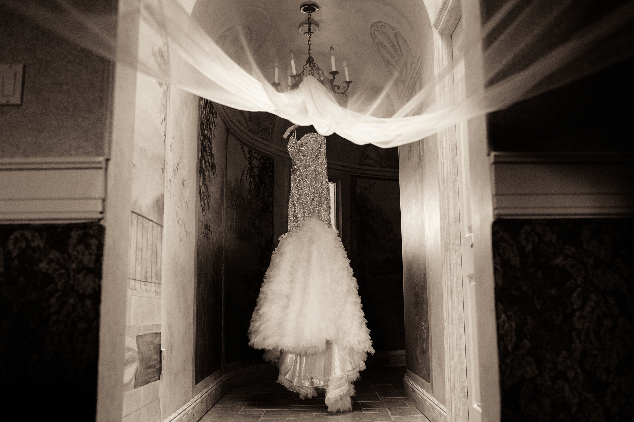 meanwhile, up in the Bridal Suite, a beautiful gown hung, patiently waiting for the bride to put on the dress of a lifetime.