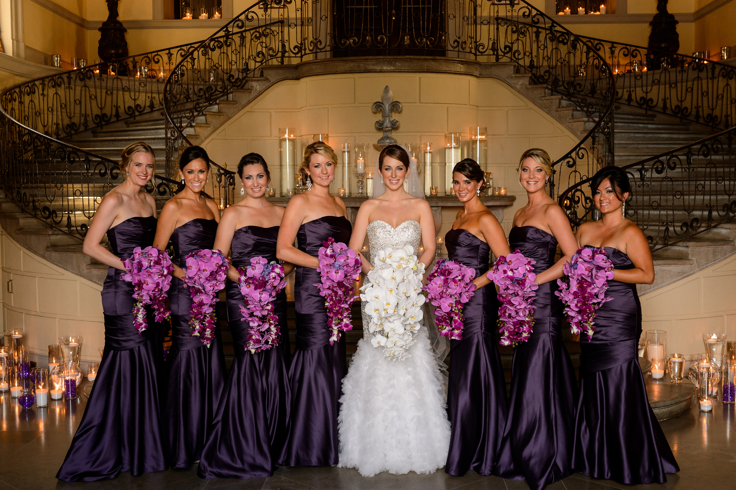 This wedding needed all the ladies to have AMAZING purple bouquets... long beautiful, trailing cascades of orchids act as jewels to their gowns.... with pops of bright color