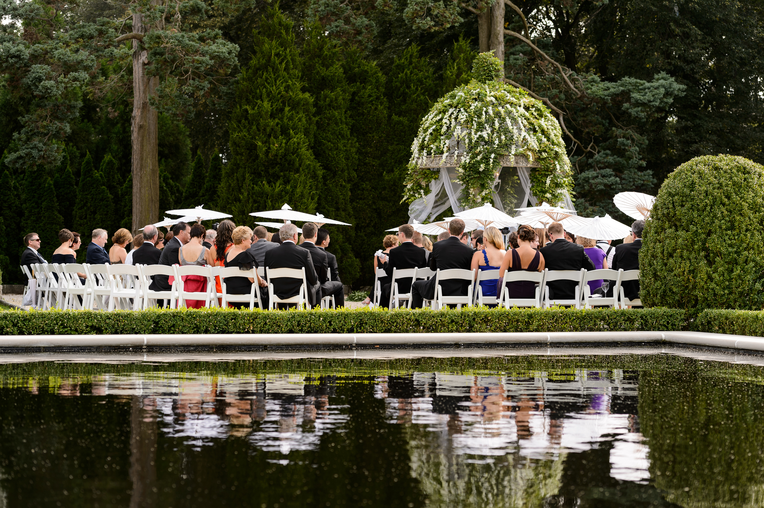 At the far end of the reflection pool, formal gardens, is a gazebo....AT this perfect little place (according to the Melius family), they do not recall ever having a wedding at this amazing spot!  It is a  perfect spot to get married.  WE brought in a chandelier, some fabric, and gave the guests parasols.... Love it!