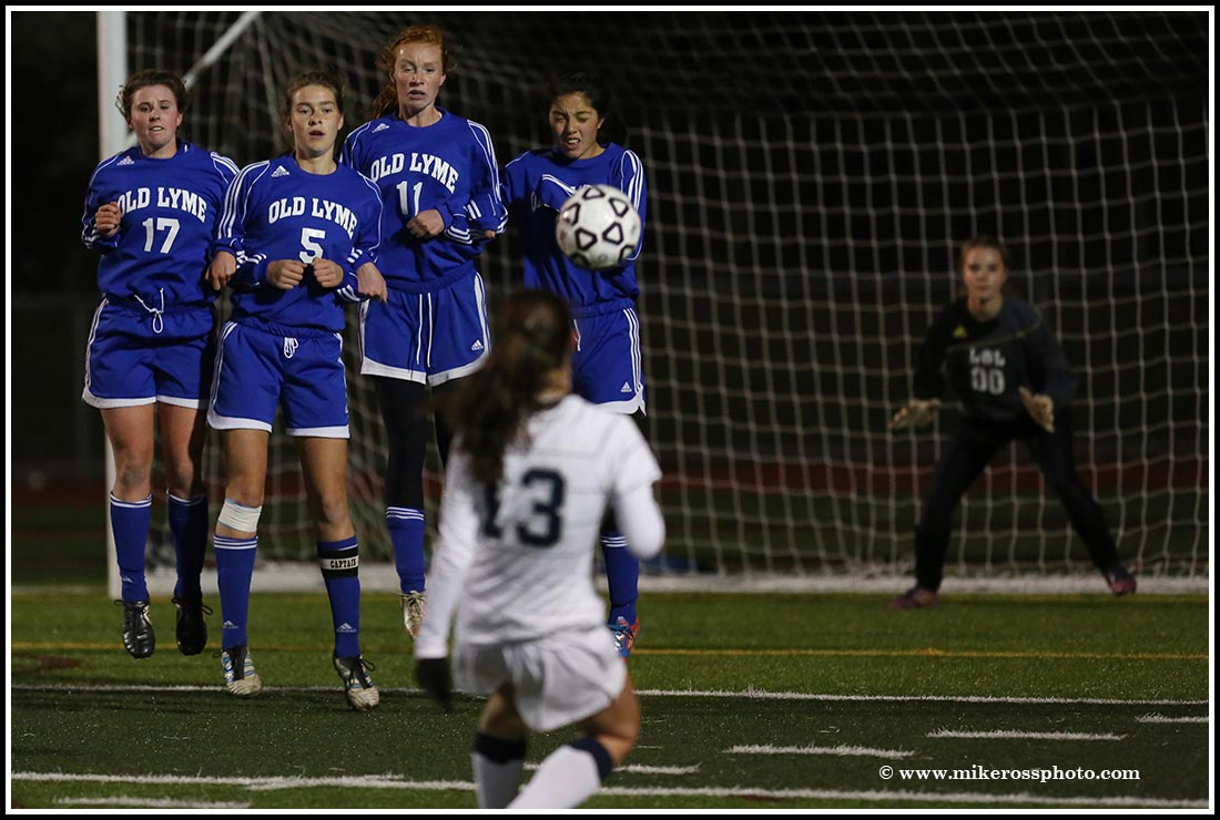 Mike Ross Connecticut freelance -Immaculate's #13 Paige Davis shoots a free kick on  Old Lyme High School during Friday evenings Class S state semifinals. Immaculate would win 1-0 and advance to Class S State Championship.