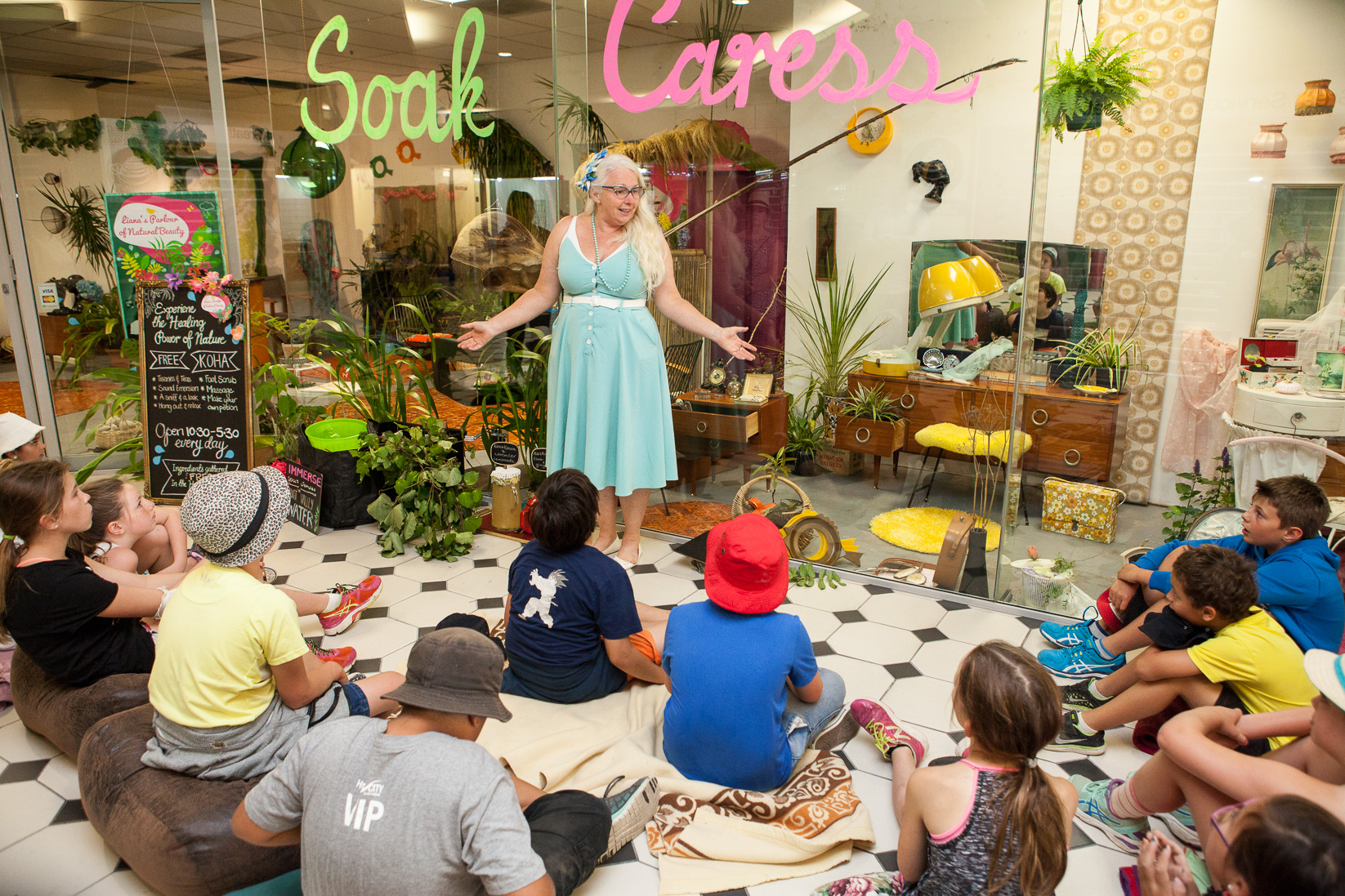 Children engage with Liana's Parlour of Natural Beauty, a recent project by Liana Stupples in Lower Hutt which brought all the natural goodness of the surrounding environment into a vacant retail space. Image: Dionne Ward