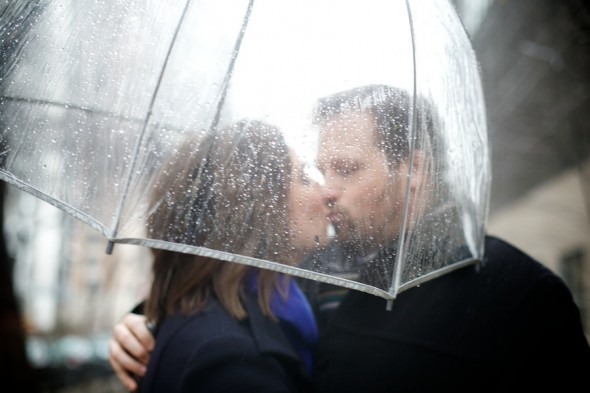 Kissing under umbrella