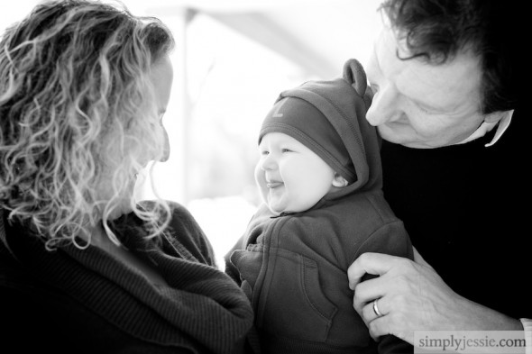 Family laughing with baby