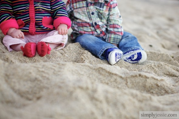Twins feet in sand