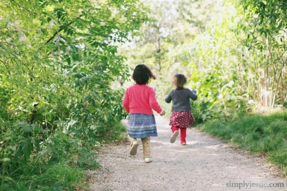 Sisters runing in park