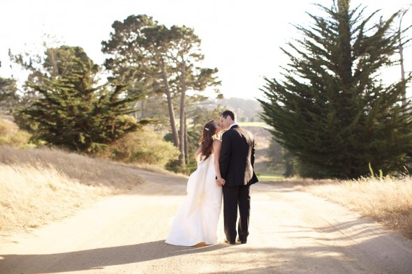 Bride and Groom walking down country road