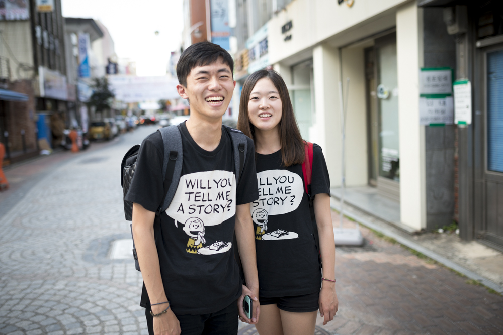 In South Korea, couples will often wear the same shirts or outfits. These two had a shirt I couldn't resist. Charlie Brown is the man.