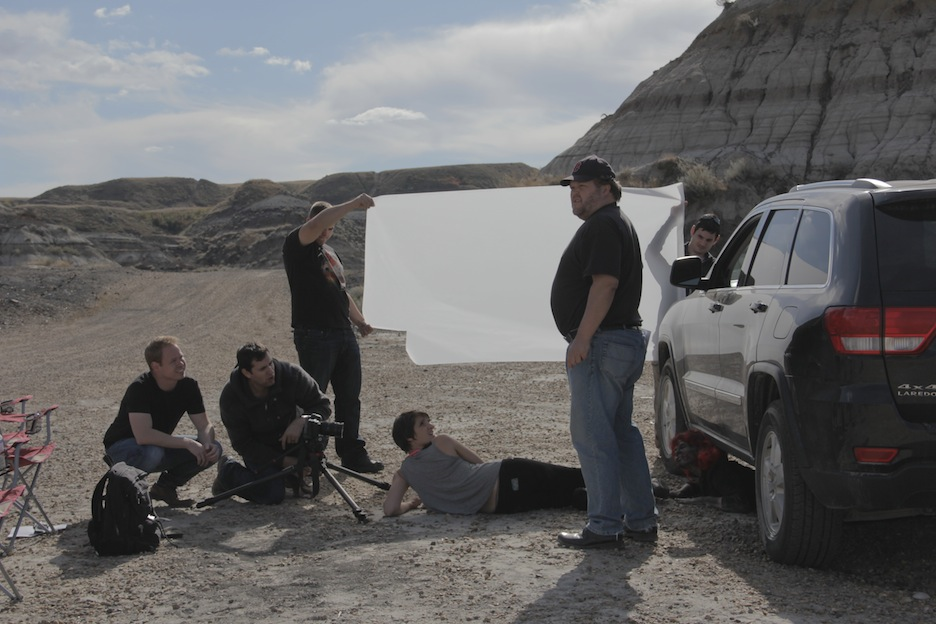 Right to left: cameraman/ninja Jon Samadopolis, writer/director Bob Schultz, stand-in Connie, PA Kyler Kotyk, DP Harry Papavlosopoulos, DP Chris Friesen. And a zombie hiding under the car.