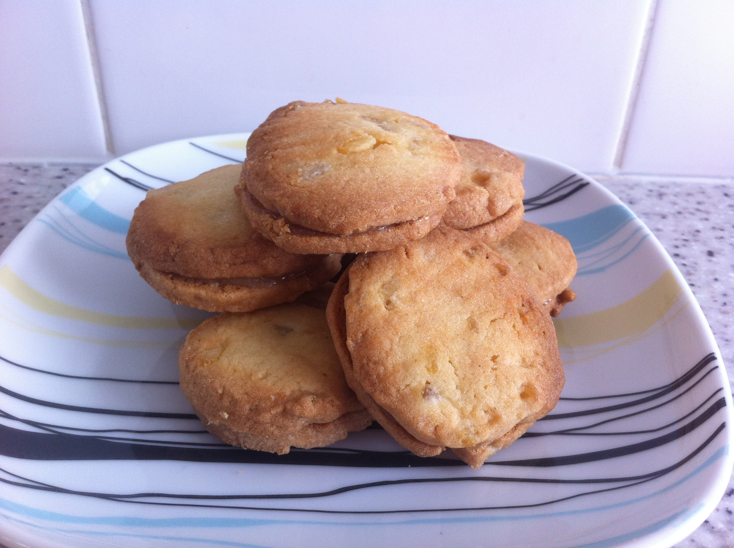 Biscuits with candied peel, sandwiched with lemon curd