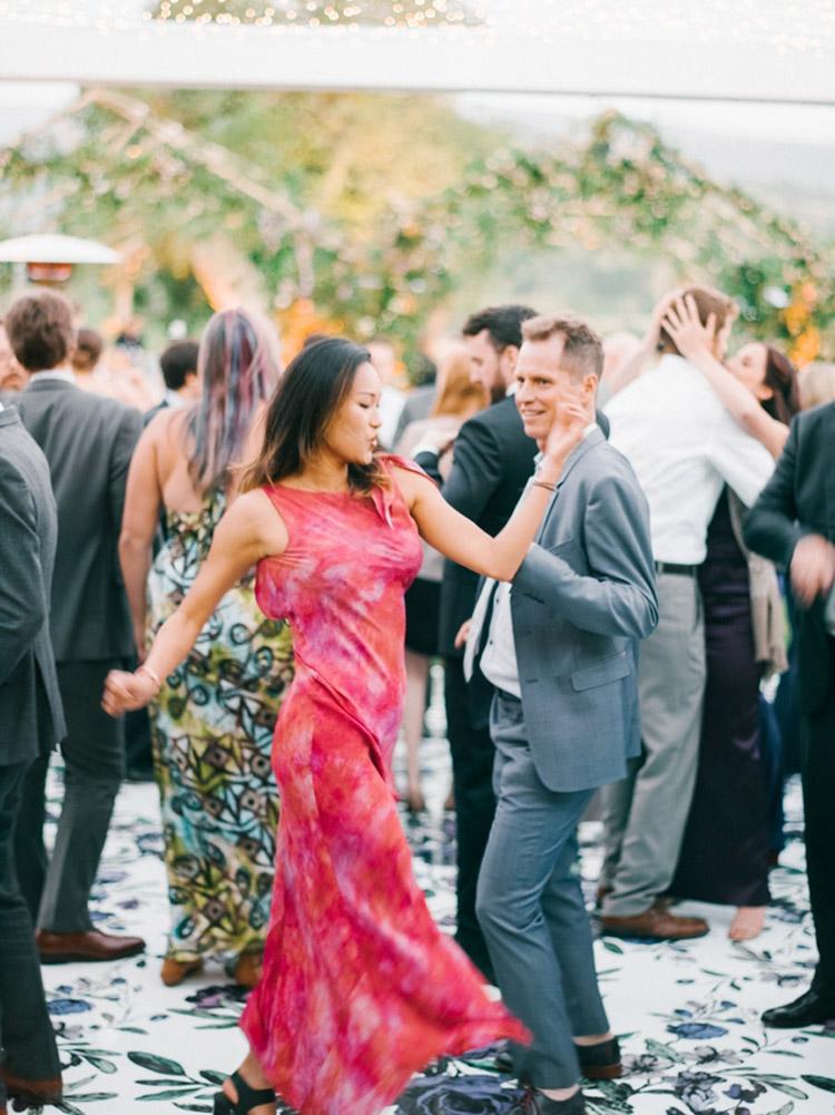 Dancing the night away on a custom floral dancefloor -