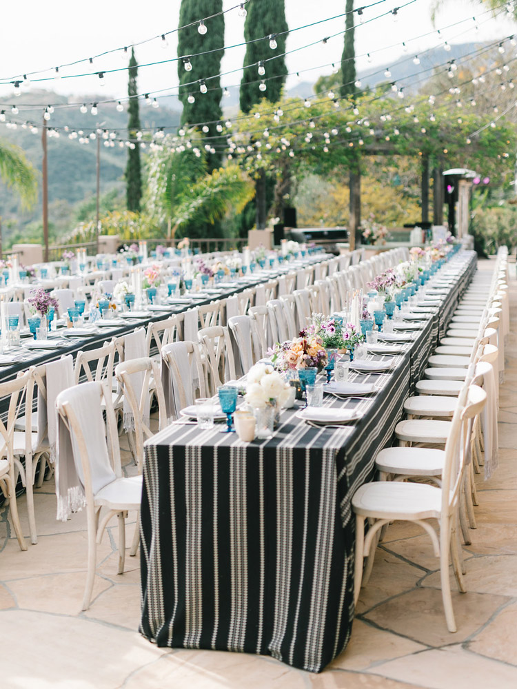 in the hills with the city below, guests dined al fresco with a sunset finale -