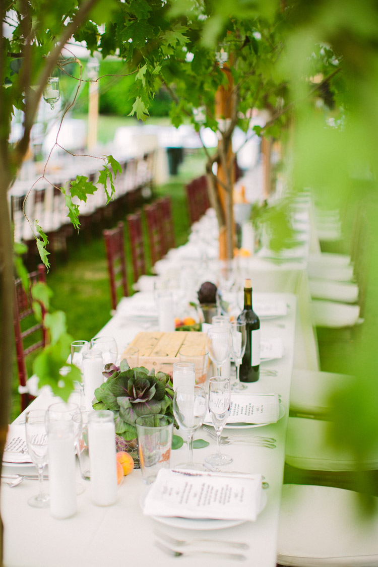 tables were decorated with the bounty of the farm, with guests dining under trees installed in the tent -