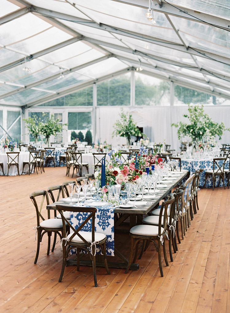 custom flooring and organic floral created texture and depth in the clear top tent -