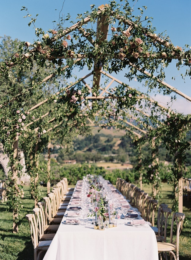 Weekend in Wine country - Los Angeles-based Jackie and Sean were married at a villa in the Santa Ynez Valley. Guests dined on a menu inspired by weekend trips they've taken together in California, and under custom pergolas draped in locally grown roses from Rose Story Farm.view more