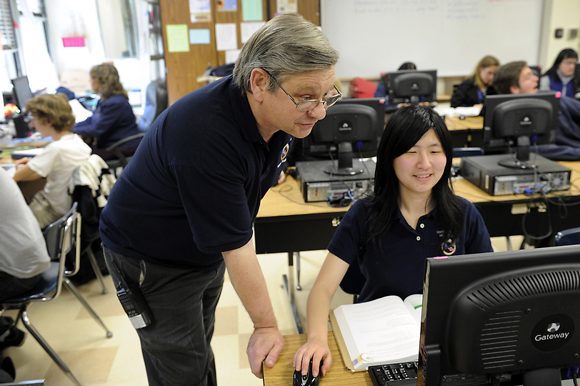 North Hollywood High School Cyberpatriots team coach Jay Gehringer checks on team member Jenny Lu, Wednesday, January 30, 2013. (Michael Owen Baker/Staff Photographer)