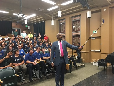 Louis Stewart of GO-Biz uses a selfie stick at the inaugural California Cyber Innovation Challenge at Sacramento City College on Wednesday.