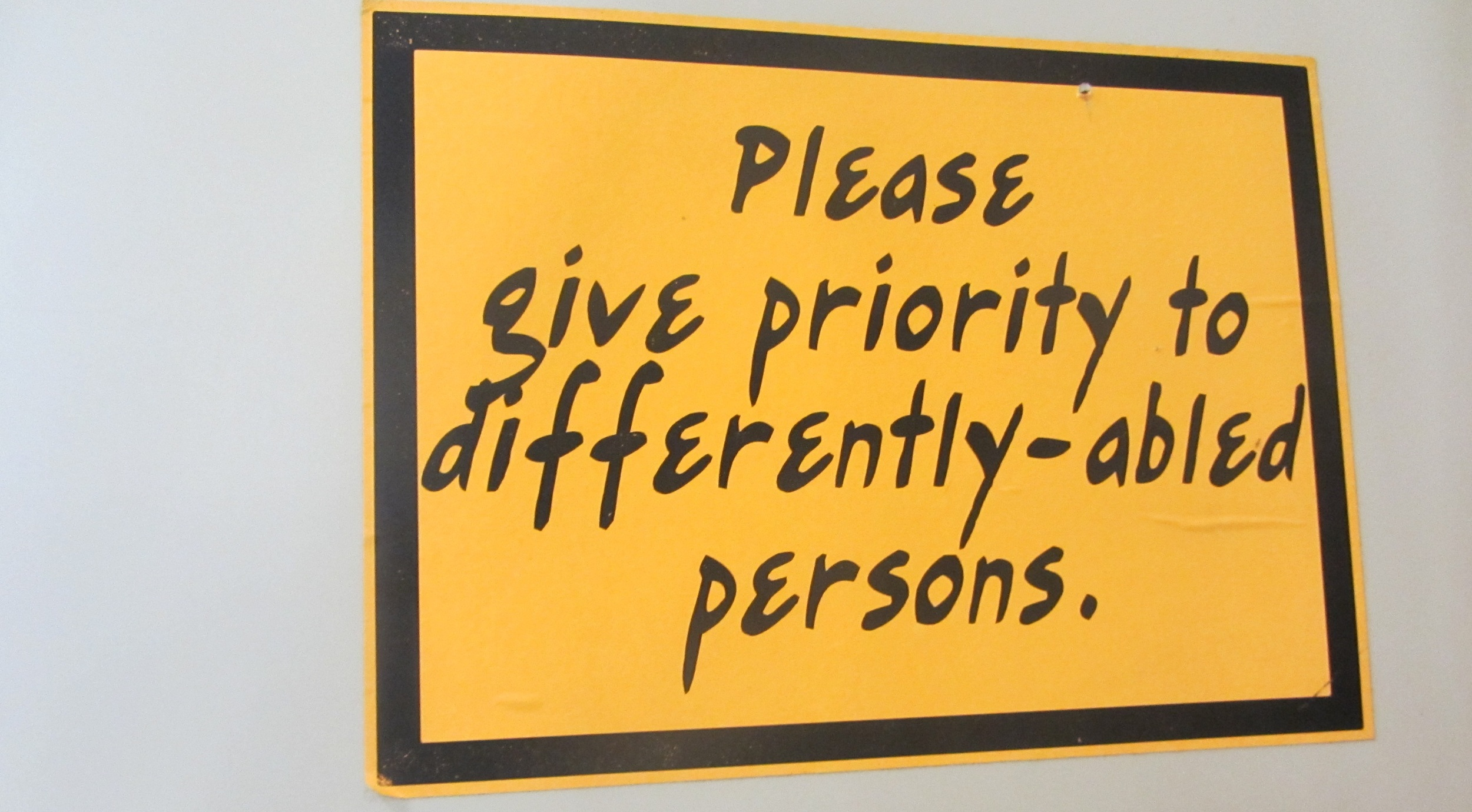 """Manners are important as this restroom sign asks: """"Please give priority for differently-abled persons""""  (Photo by Lisa Suguitan Melnick)"""