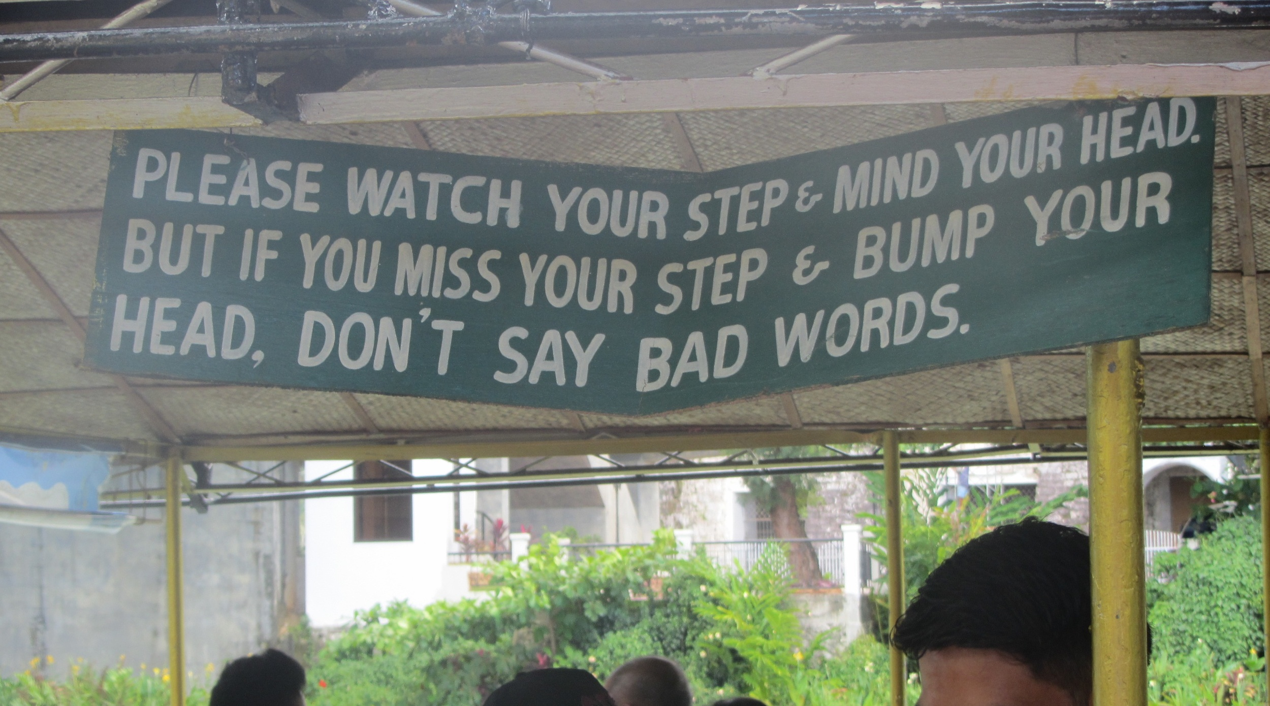 """A reassuring banner on the river boat to Bohol reminded: """"Please Watch Your Step and Mind Your Head. But if you miss your step and bump your head, don't say bad words."""" (Photo by Lisa Suguitan Melnick)"""