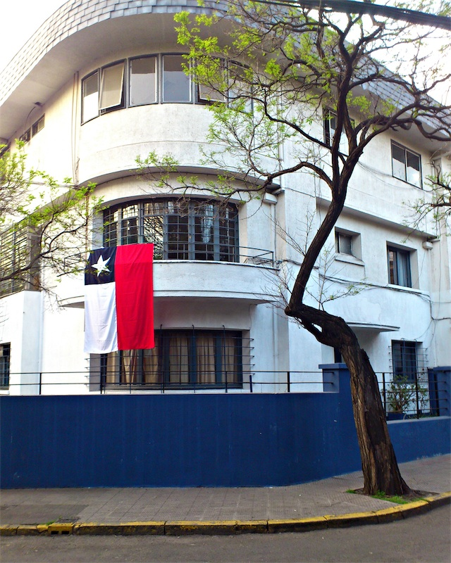The Chilean flag hangs from the balcony of a house in the Providencia commune during Dieciocho, the country's Independence Day celebrations.  (Photo byMigs Bassig)