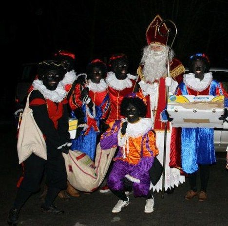 More on Sinterklaas and the zwarte pieten  http://en.wikipedia.org/wiki/Sinterklaas      (Image:  www.aanbod.be )