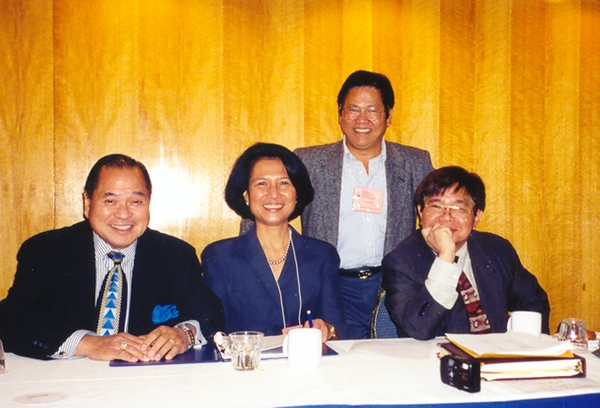 Alex Esclamado and Loida Nicolas-Lewis pursued the goal of uniting Filipino associations in the U.S. together with other leaders of the National Federation of Filipino American Associations (NaFFA), Greg Macabenta (standing) and Jon Melegrito (right).  (Courtesy of  Filipinas Magazine )