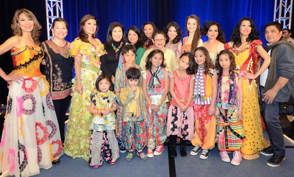 Designer Patis Tesoro (center with glasses) poses with her models and choreographer Ogee Atos (right) at the annual fashion show fundraiser of the Philippine International Aid (PIA) in San Francisco, November 2012.