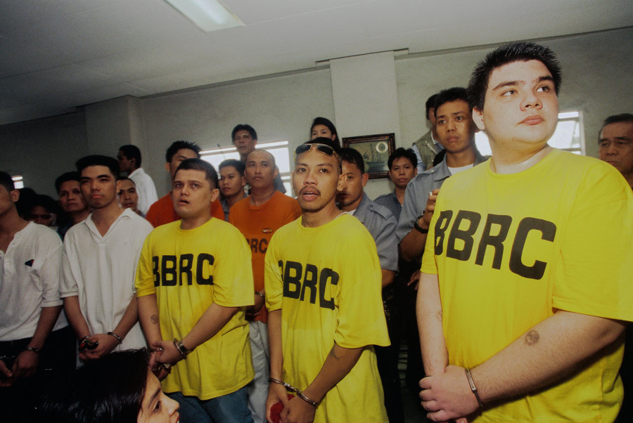 """Paco Larrañaga (right), a culinary student from Cebu, Philippines, was arrested for the kidnap, rape and murder of Jacqueline and Marijoy Chiong. His ordeal was the subject of award-winning documentary """"Give Up Tomorrow"""" by Marty Syjuco and Michael Collins. With co-accused Josman Aznar (left) and Rowen Adlawan.   (Photo by Alex Badayos. Source:  giveuptomorrow.com )"""