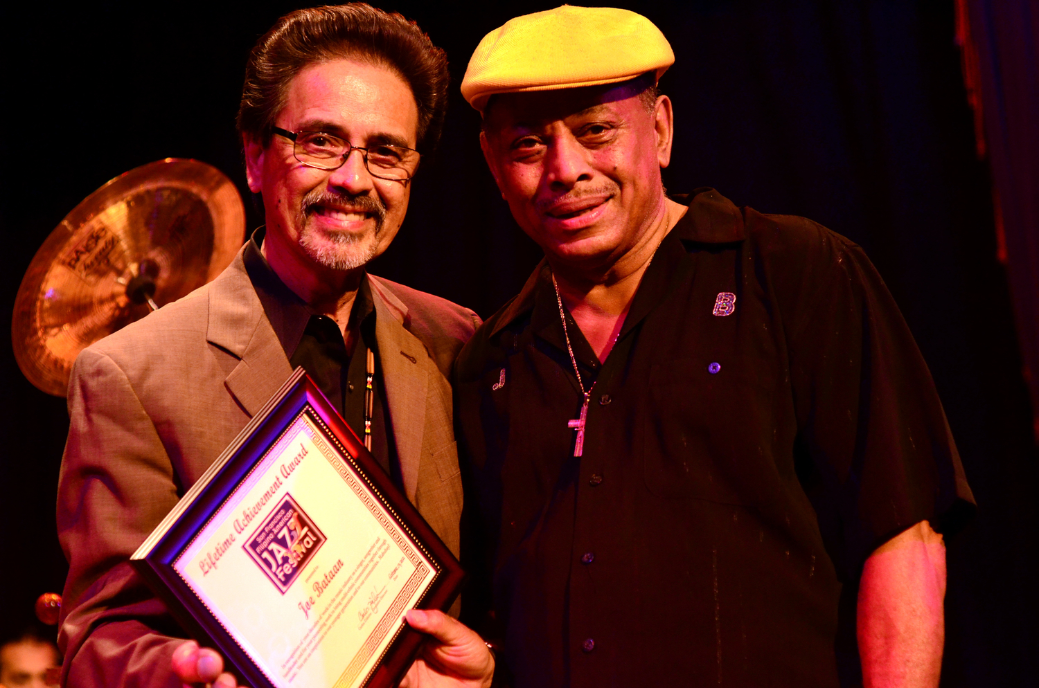 Joe Bataan (right) being honored with the San Francisco Filipino American Jazz Festival Lifetime Achievement Award by fellow Fil-Am jazz artist Carlos Zialcita at Yoshi's Oakland, Oct. 13, 2012.  (Photo by Henry Cheung)