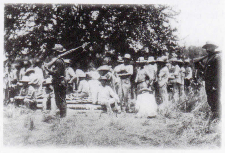 End of the Road: Black U.S. troopers guarding Spanish prisoners  (Source: the Anthony Powell Collection)
