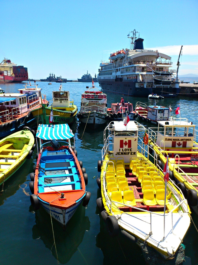 Boat tours that pass alongside container ships, cargo vessels, and sea lions are available at the colorful port of Valparaíso.