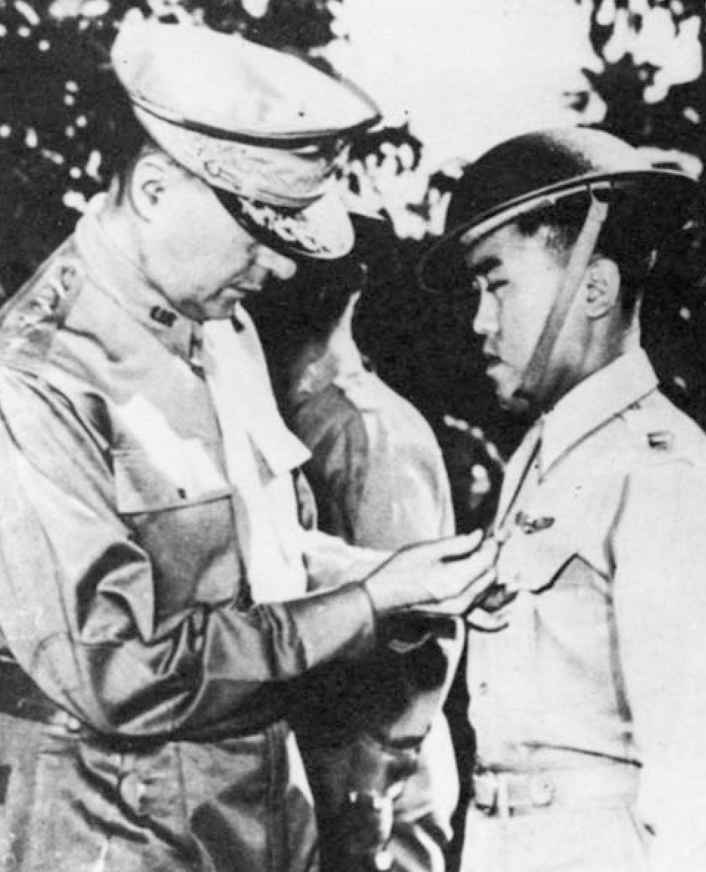 Gen. MacArthur awards the U.S. Distinguished Service Cross to Villamor for his heroic action in an aerial combat against superior Japanese zeros. This is one of 13 medals for valor Villamor earned in WWII.