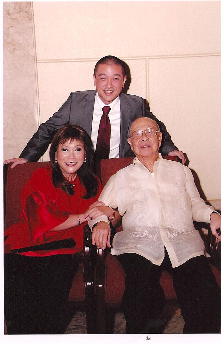 MonaLisaYuchengcowithfatherAmbassadorAlfonsoYuchengco(seated)andsonPaoloAbaya (PhotocourtesyofMonaLisaYuchengco)