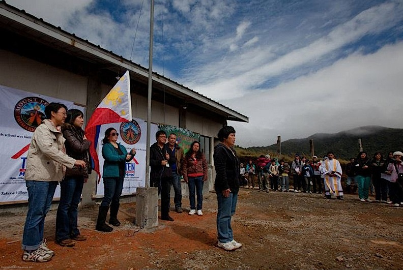 Flag-raising ceremony during the inauguration of the new school.  (Photo by Rick Rocamora)