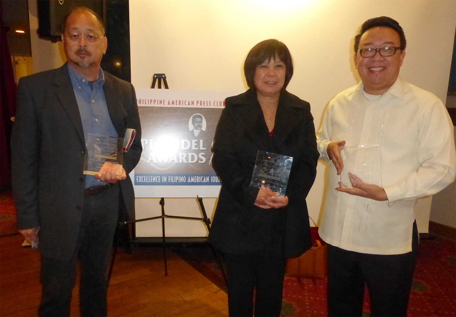 Positively Filipino's Rene Ciria-Cruz, Gemma Nemenzo and Raymond Virata accept the 2013 Plaridel Awards on behalf of winners Lotis Key, Francis Calpotura and Elizabeth Ann Quirino.  (Photo by I. Wilfredo Ver)