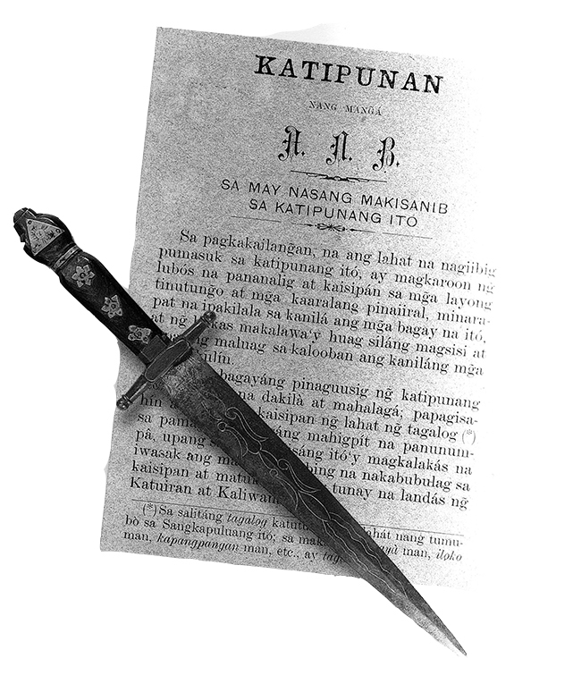 """The tools used during the Katipunan's secret initiation rites: the Kartilya, the guidebook of the Katipunan, and the dagger used by new members to draw blood to sign their oath of allegiance. (Source: Felice Prudente Santa Maria's """"Visions and Possibilities"""")"""
