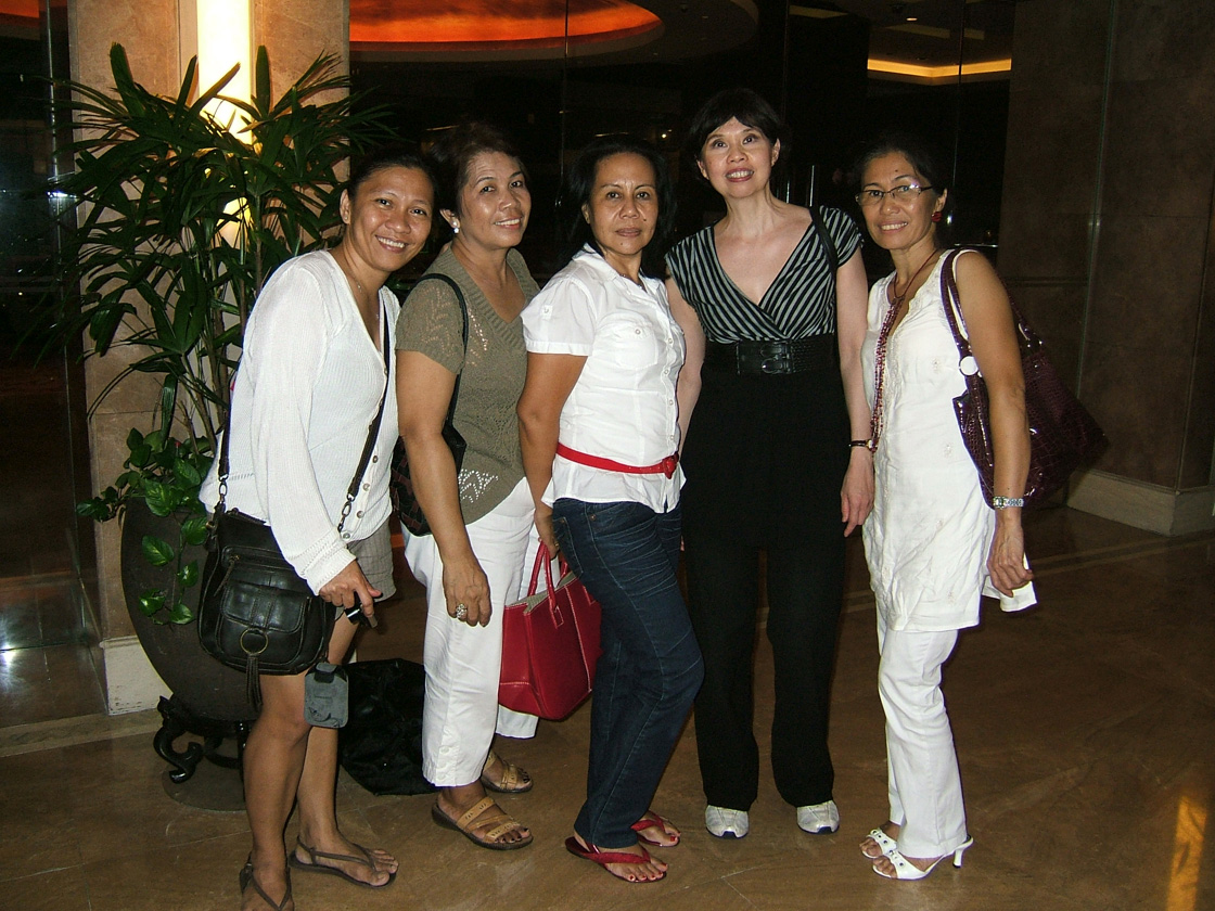 Mina Roces, fourth from left, with Filipino workers in Singapore  (Photo courtesy of Mina Roces)
