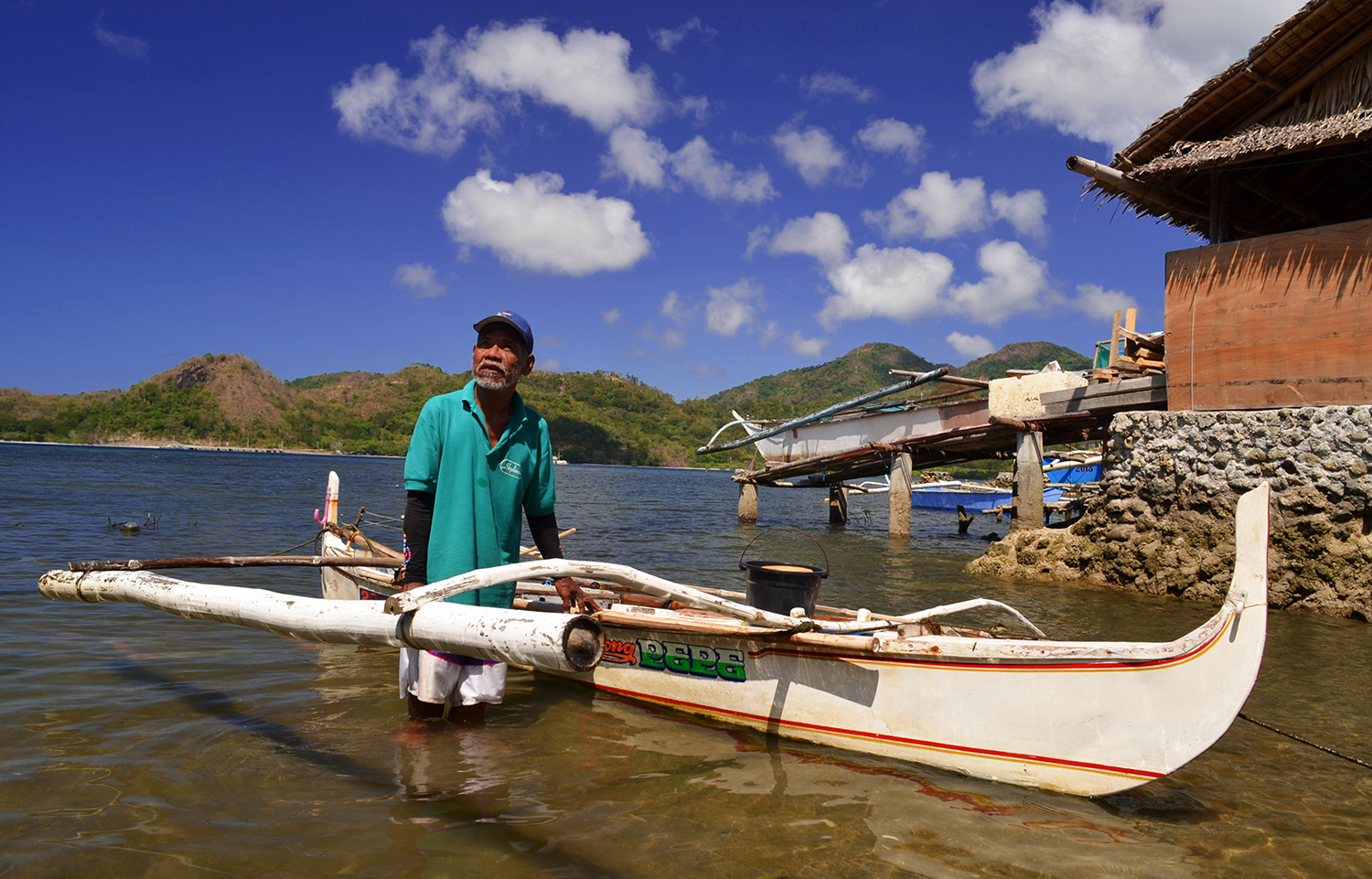 A Filipino fisherman and his banca, the traditional outrigger boat  (Photo by Gregg Yan/WWF)