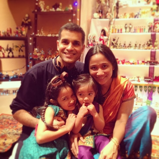 """Taking in the beautiful """"Bombe Habba"""" display at the Sawhney's friend's house. The festival or dolls is definitely one that their kids enjoy. (Photo courtesy of Regina Manzana-Sawhney)"""