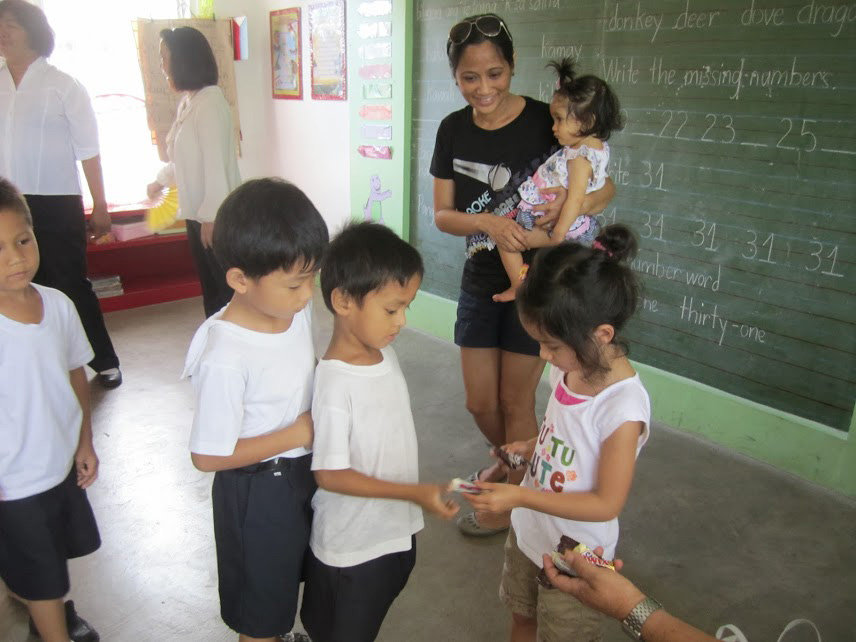 Every time we bring the girls, we take them to a local school we support through AGAPP (Aklat, Gabay, Aruga tungo sa Pag-angat at Pag-asa). One of my favorite things about this is the sharing. Local kids often sing a song and my daughter will do the same - great insight into each others worlds! (Photo courtesy of Regina Manzana-Sawhney)
