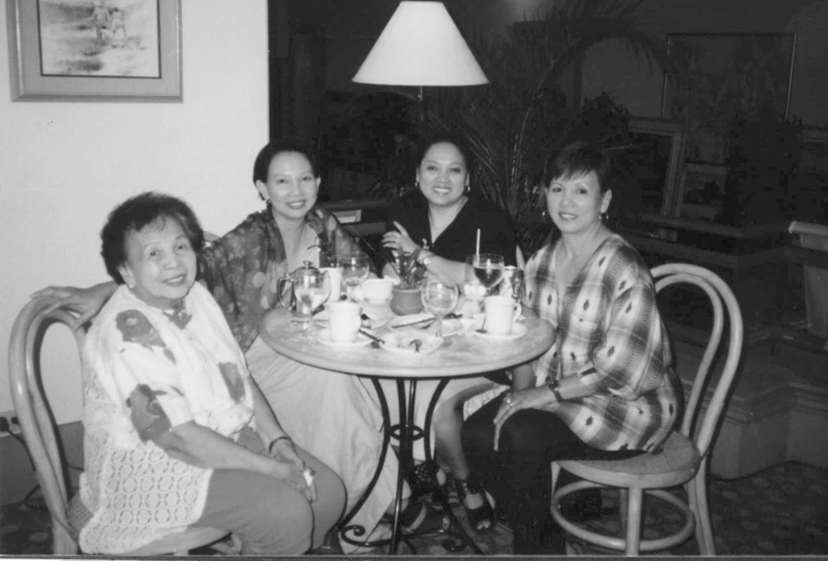 Leny Strobel (second from left) says family members not directly involved in caring for their aging parents are prone to more stress. With her mother Esperanza and sisters Millie (right) and Roxie. (Source:  Filipinas Magazine,  September 2004)