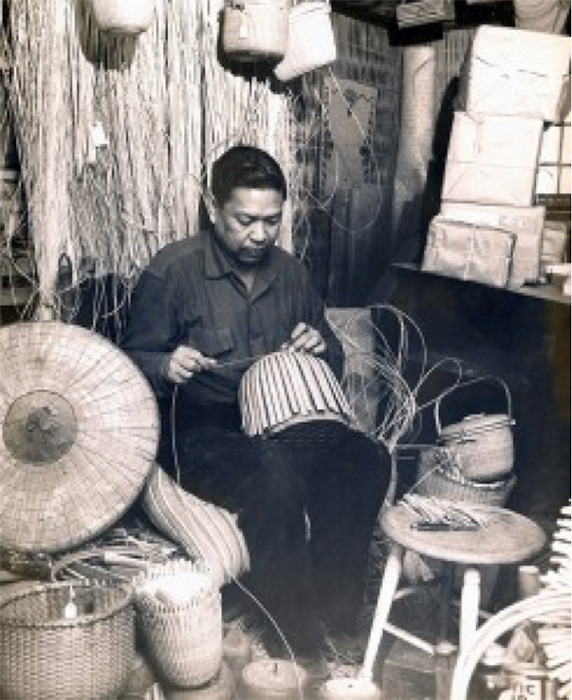 Jose F. Reyes at work in his basket studio in Nantucket, circa 1970. Note the salakot on the left side. The studio was donated to the Nantucket Historical Association. (Photo courtesy of the Nantucket Historical Association)