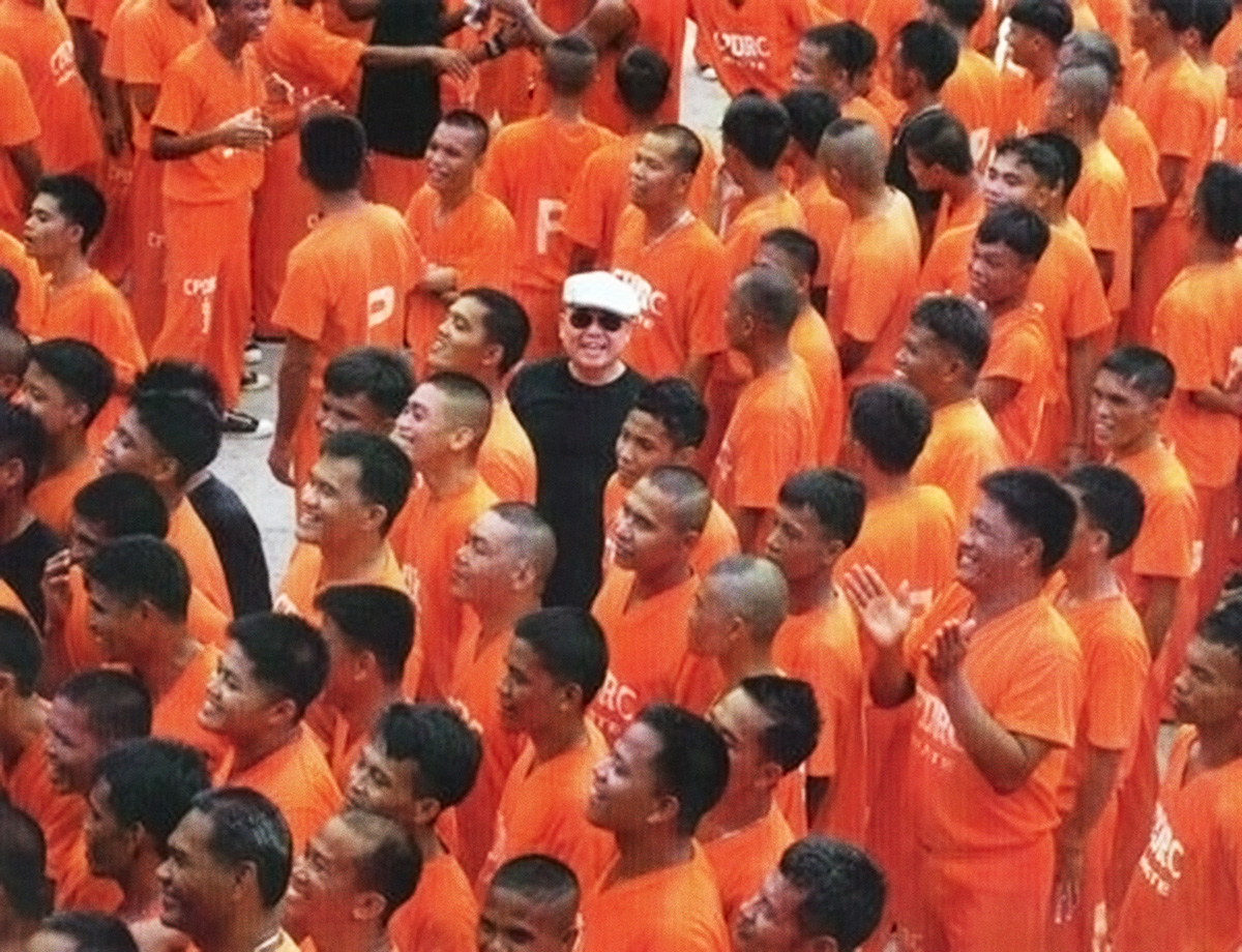 """Fritz Friedman with the Cebu prisoners who danced to """"They Don't Care About Us"""" in support of the global release of the Michael Jackson documentary """"This Is It,"""" on Blu-ray. He was co-producer and brought Michael Jackson's choreographer and some dancers to the Cebu prison. (Photo courtesy of Fritz Friedman)"""