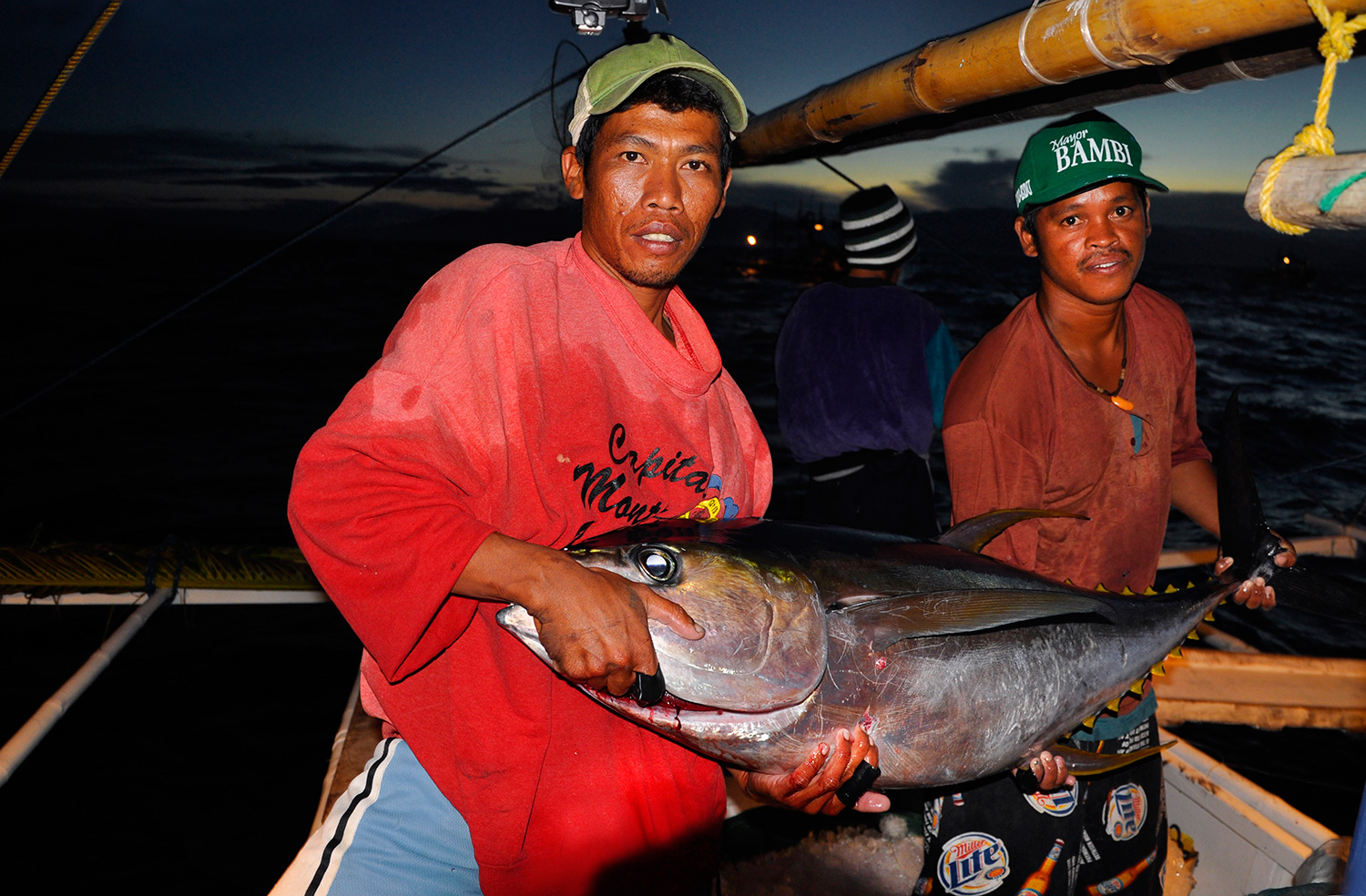 Tuna fishermen and their prized catch (Photo by Gregg Yan / WWF)